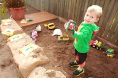 child having fun in the dirt