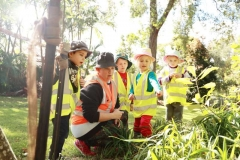 children learning about the garden with there educator